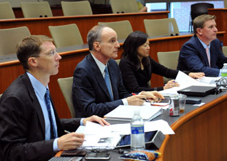 From left to right, Finance Case Competition judges Chris Conoscenti, Chuck Tilis, Claire Liu and Joe Agular.