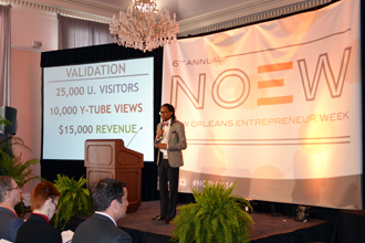 Tulane Business Model Competition finalist Ras Asan, chief operating officer of Million Dollar Scholar, presents to the judging panel at New Orleans Entrepreneur Week. (Photo by Maggy Baccinelli)