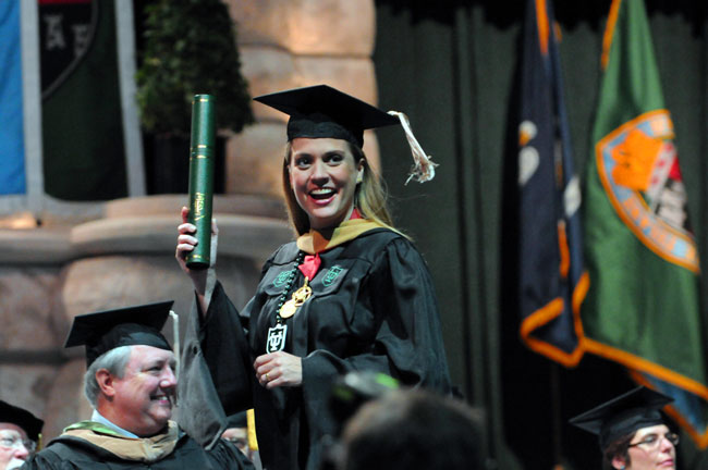 Maria Luisa Plaut shows off her just-received Master of Global Management diploma.