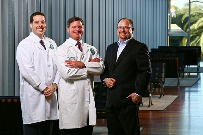 Anesthesiology resident Jonathan Eskander, left, with Michael Yarborough, head of the School of Medicine's residency program, and John Clarke, associate dean for graduate programs at the Freeman School, recently began the Professional MBA program.
