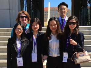"Freeman 2016 TIPS Portfolio Management Competition team featured, front row, left to right, Xiuhong ""Maggie"" Wu, Qi Chen, Jiaqi ""Jackie"" Bai and Scherzade ""Sherry"" Agha, and back row, far right, Lingpeng ""Don"" Xiao. Also pictured is Ashley Nelson, professor of practice in management communication, who accompanied the team."
