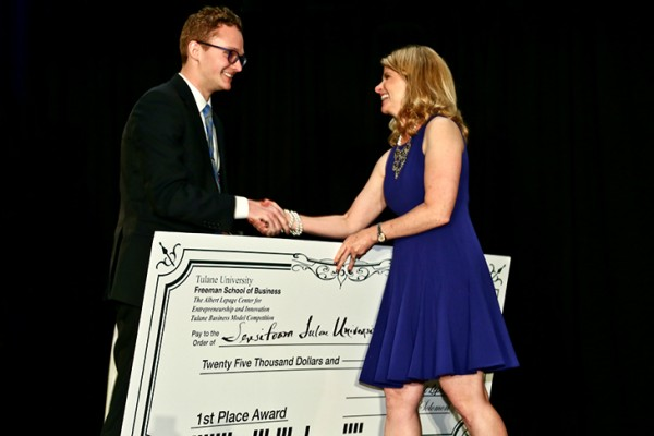 Chris Sloas, left, a 2015 graduate of the Tulane School of Science and Engineering, is congratulated by Stephanie Kleehammer, director of outreach and communications with the Lepage Center for Entrepreneurship and Innovation, after winning the 2016 Tulane Business Model Competition. (Photo by Guillermo Cabrera-Rojo)