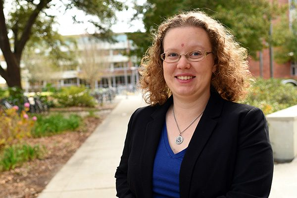 Assistant Professor of Finance Candace Jens finds that firms reduce their capital expenditures by up to 15 percent prior to elections.