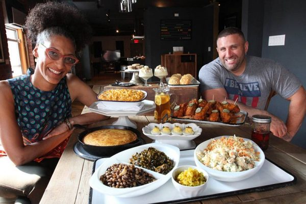 Tulane University alumnus Evan Darnell and celebrity chef Carla Hall are the founders of Carla Hall's Southern Kitchen in Brooklyn, New York. (Photo provided by Evan Darnell)