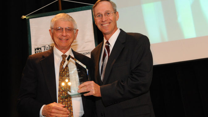 Sid Pulitzer, left, receives the 2011 Tulane Outstanding Entrepreneur of the Year Award from John Elstrott.