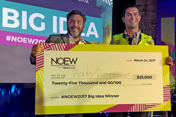 Justin Dangel, left, and Tulane alumnus Benjamin Swig, right, accept the grand prize from the Big Idea competition during New Orleans Entrepreneur Week on Friday (March 24) for their startup, Ready Responders. (Photo provided)