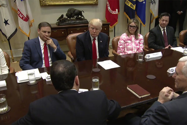 Drew Greenblatt, with his back to the camera, speaks to President Trump about Marlin Steel during a meeting at the White House on March 31.