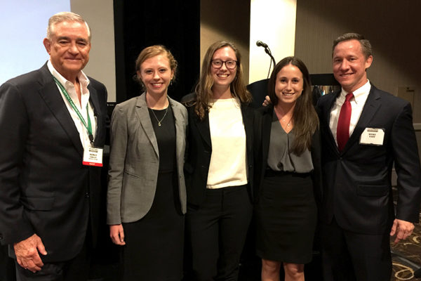Students X, Y and Z, center left to right, earned first place in the third annual Distressed Debt Investment Pitch Competition. Also picture are, left, investor Dewey Selber, a colleague of Selber's, and Myke Yest, course instructor.
